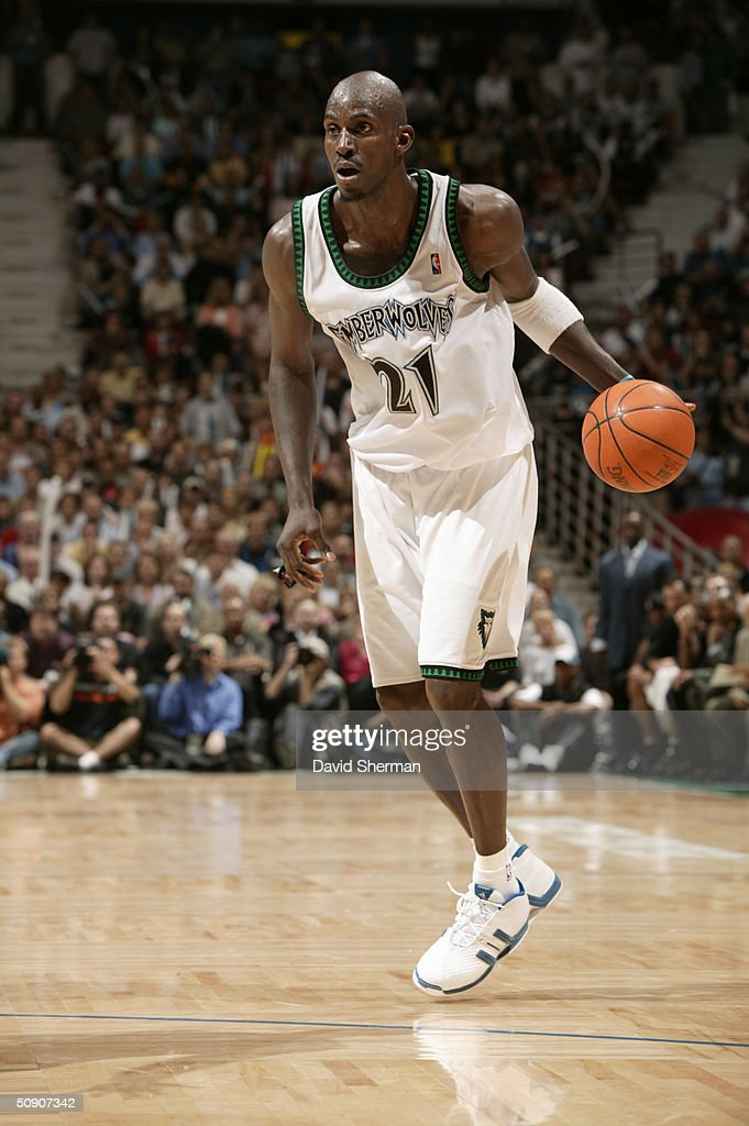Kevin Garnett #21 of the Minnesota Timberwolves dribble drives against the Sacramento Kings in Game Seven of the Western Conference Semifinals during the 2004 NBA Playoffs at Target Center on May 19, 2004 in Minneapolis, Minnesota. The Timberwolves won 83-80.