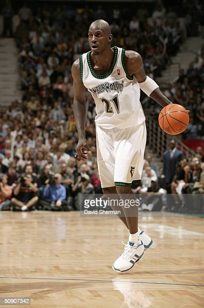 Kevin Garnett of the Minnesota Timberwolves dribble drives against the Sacramento Kings in Game Seven of the Western Conference Semifinals during the...