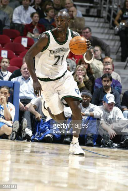 Kevin Garnett of the Minnesota Timberwolves dribbles the ball as he runs the play upcourt against the Orlando Magic during the game on February 3...
