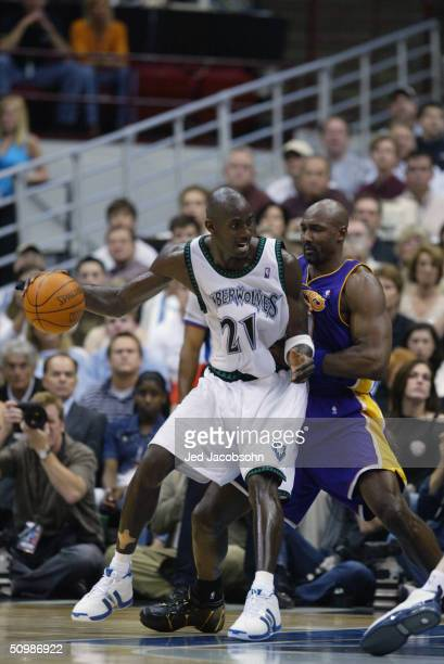 Kevin Garnett of the Minnesota Timberwolves drives against Karl Malone of the Los Angeles Lakers in Game five of the Western Conference Finals during...