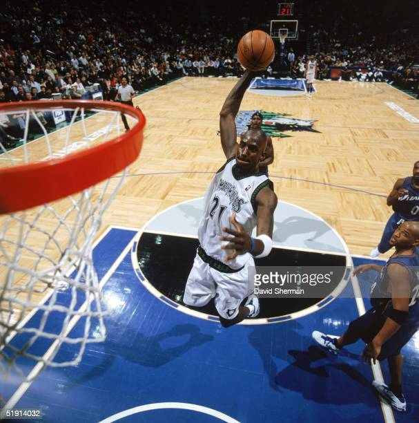 Kevin Garnett of the Minnesota Timberwolves drives to the basket for a dunk during a game against the Washington Wizards at Target Center on December...