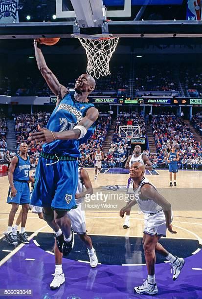 Kevin Garnett of the Minnesota Timberwolves dunks against the Sacramento Kings circa 1997 at Arco Arena in Sacramento California NOTE TO USER User...
