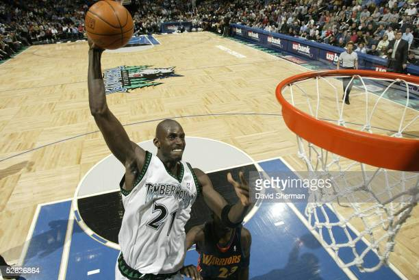 Kevin Garnett of the Minnesota Timberwolves dunks in a game against the Golden State Warriors on April 13 2005 at the Target Center in Minneapolis...