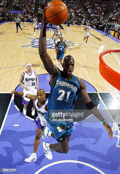 Kevin Garnett of the Minnesota Timberwolves dunks the ball against of the Sacramento Kings during Game three of the Western Conference Semifinals of...
