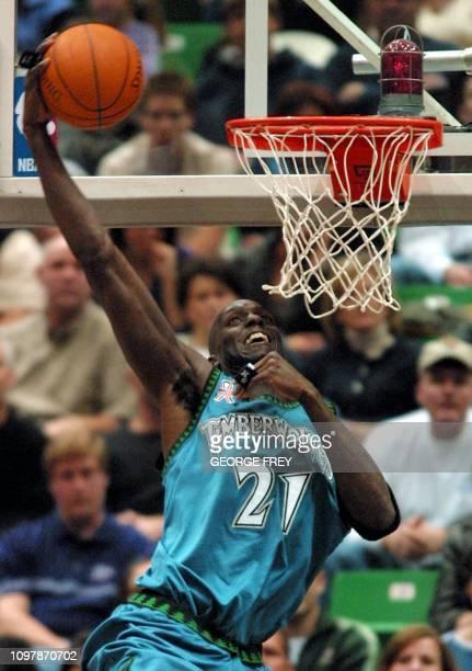 Kevin Garnett of the Minnesota Timberwolves dunks the ball against the Utah Jazz during the third quarter 02 March 2002 in Salt Lake City Utah AFP...