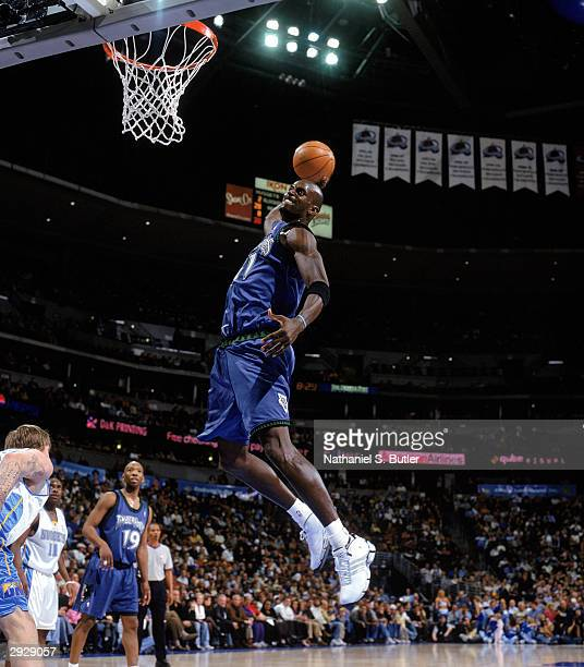 Kevin Garnett of the Minnesota Timberwolves dunks the ball during the NBA game against the Denver Nuggets at Pepsi Center on January 26 2004 in...