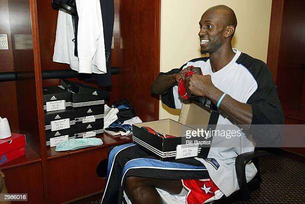 Kevin Garnett of the Minnesota Timberwolves gets ready in the Western Conference Locker room prior the 2004 NBA AllStar Game February 15 2004 at the...