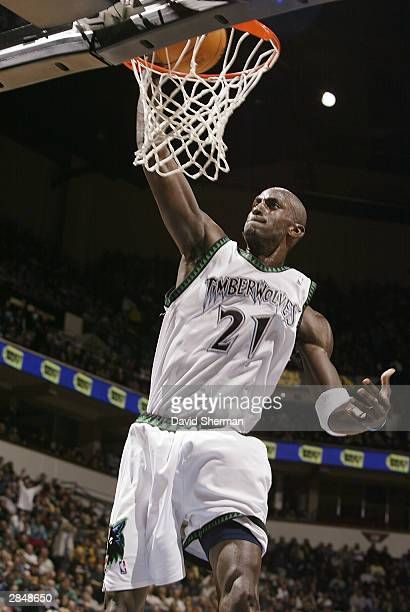 Kevin Garnett of the Minnesota Timberwolves goes up for the slam dunk against the Los Angeles Lakers on January 6 2004 at Target Center in...