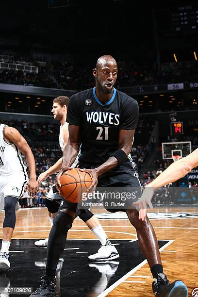 Kevin Garnett of the Minnesota Timberwolves handles the ball during the game against the Brooklyn Nets on December 20 2015 at Barclays Center in...