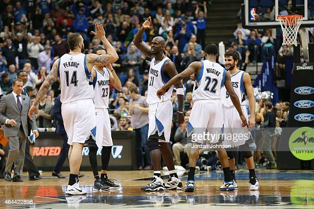 Kevin Garnett of the Minnesota Timberwolves high fives teammates after the game against the Washington Wizards on February 25 2015 at Target Center...