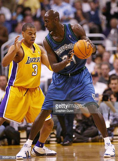 Kevin Garnett of the Minnesota Timberwolves is defended by Devean George of the Los Angeles Lakers in Game three of the Western Conference Finals...