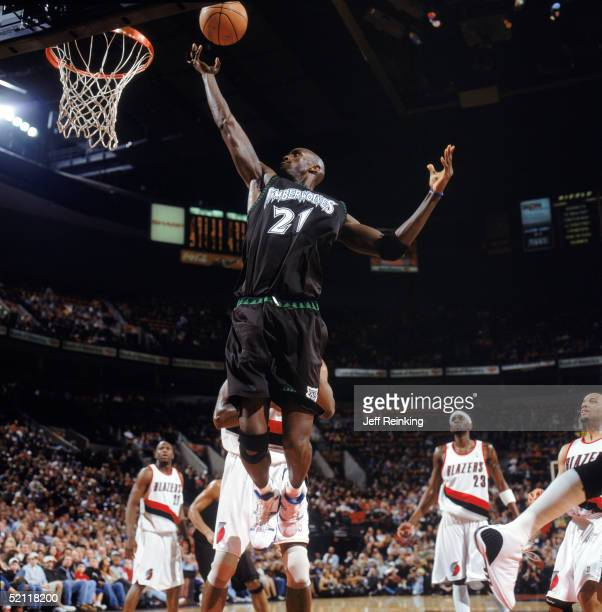 Kevin Garnett of the Minnesota Timberwolves lays up a shot during a game against the Portland Trail Blazers at The Rose Garden on January 22 2005 in...