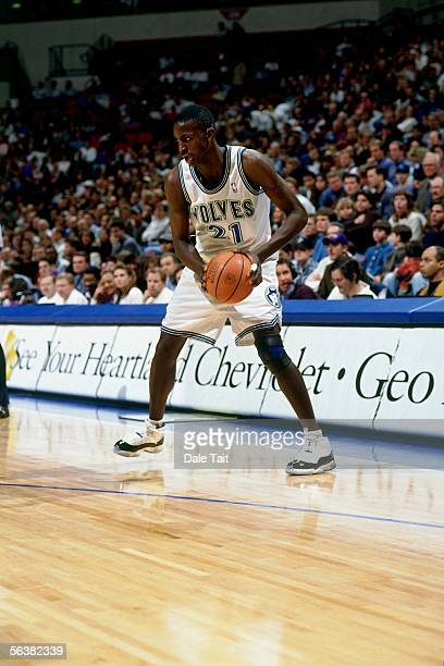 Kevin Garnett of the Minnesota Timberwolves looks to make a move against the Seattle Sonics during an NBA game at the Target Center on November 22...