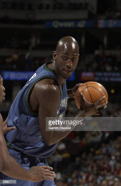 Kevin Garnett of the Minnesota Timberwolves looks to play the ball against Earl Boykins of the Denver Nuggets during the game at Pepsi Center on...