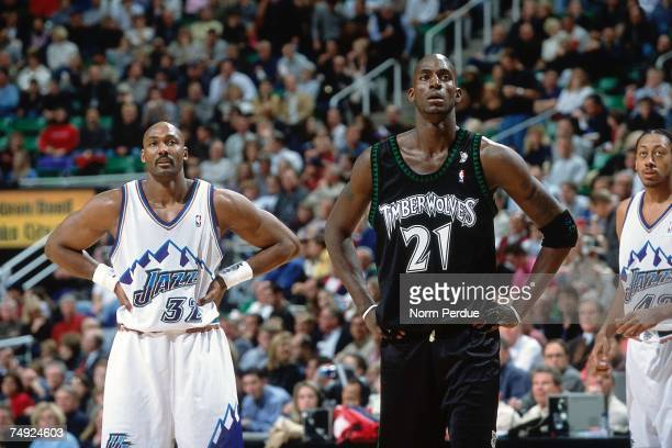 Kevin Garnett of the Minnesota Timberwolves matches up against Karl Malone of the Utah Jazz during a 2001 NBA game at the Delta Center in Salt Lake...