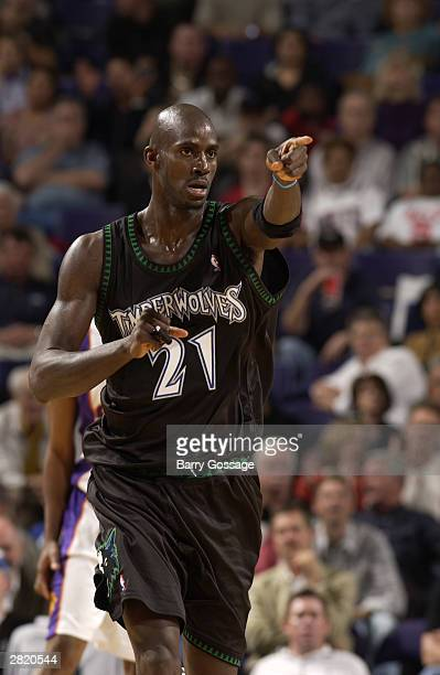 Kevin Garnett of the Minnesota Timberwolves points to a teammate during the game against the Phoenix Suns at America West Arena on December 3 2003 in...