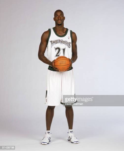 Kevin Garnett of the Minnesota Timberwolves poses for a portrait during NBA Media Day on October 4, 2004 in Minneapolis, Minnesota. NOTE TO USER:...