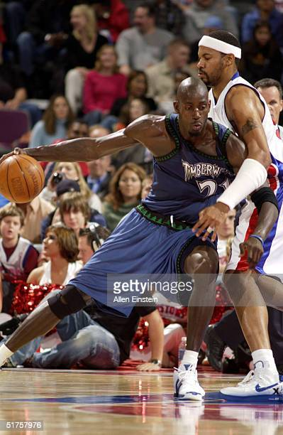 Kevin Garnett of the Minnesota Timberwolves posts up Rasheed Wallace of the Detroit Pistons on November 17 2004 during their game at the Palace of...