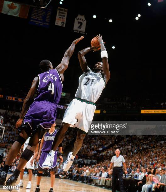 Kevin Garnett of the Minnesota Timberwolves puts a shot up against Chris Webber of the Sacramento Kings in Game Seven of the Western Conference...