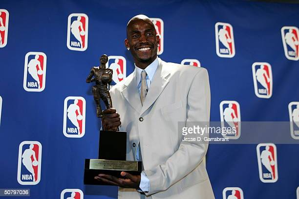 Kevin Garnett of the Minnesota Timberwolves receives the NBA MVP award on May 3 2004 at the Target Center in Minneapolis Minnesota NOTE TO USER User...