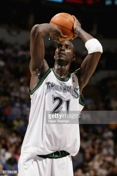 Kevin Garnett of the Minnesota Timberwolves shoots a free throw against the Detroit Pistons during the game at Target Center on January 24 2005 in...