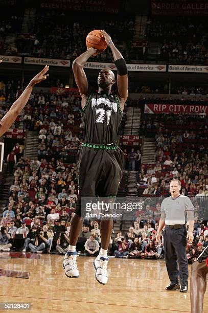 Kevin Garnett of the Minnesota Timberwolves shoots during the game against the Portland Trail Blazers at the Rose Garden on January 22 2005 in...