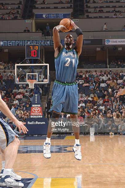 Kevin Garnett of the Minnesota Timberwolves shoots the ball during the game with the Memphis Grizzlies at FedexForum on March 18 2005 in Memphis...