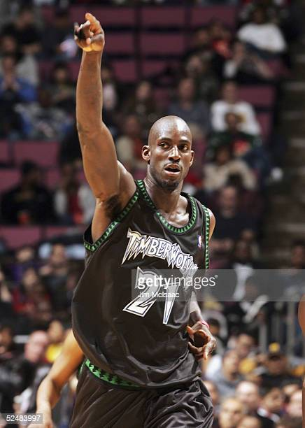 Kevin Garnett of the Minnesota Timberwolves signals to a teammate who scored a basket against the New Jersey Nets during their game on March 26, 2005...