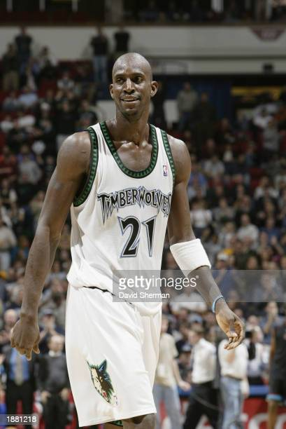 Kevin Garnett of the Minnesota Timberwolves smiles as he walks downcourt during the NBA game against the Memphis Grizzlies at Target Center on March...