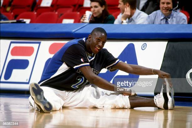 Kevin Garnett of the Minnesota Timberwolves stretches prior to playing an NBA game against the Golden Stat Warriors on January 17 1996 at the Target...