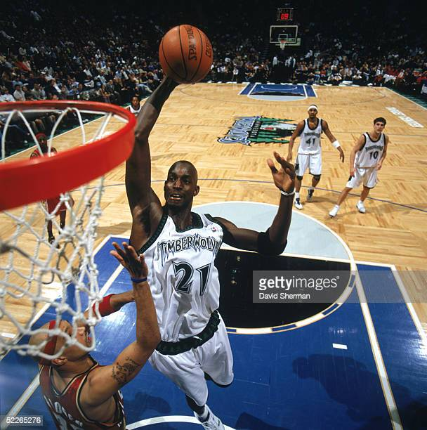 Kevin Garnett of the Minnesota Timberwolves takes the ball to the basket over Drew Gooden of the Cleveland Cavaliers during a game at Target Center...