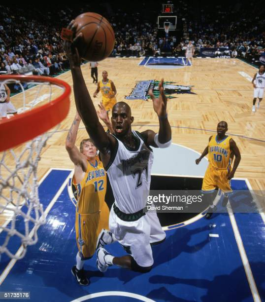 Kevin Garnett of the Minnesota Timberwolves takes the ball to the rim against Chris Andersen of the New Orleans Hornets during the game at Target...