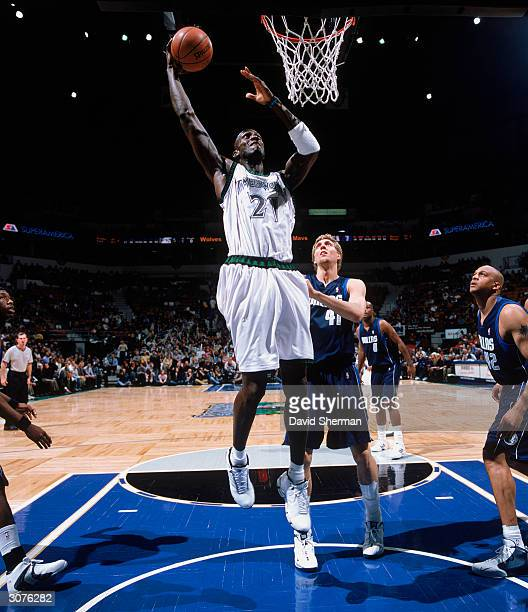 Kevin Garnett of the Minnesota Timberwolves takes the ball up against Dirk Nowitzki of the Dallas Mavericks during the NBA game at Target Center on...