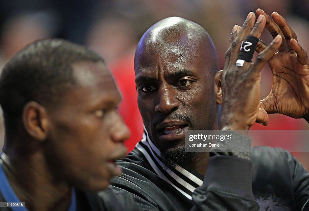 Kevin Garnett #21 of the Minnesota Timberwolves talks with teammate Gorgui Dieng #5 on the bench during a game against the Chicago Bulls at the United Center on February 27, 2015 in Chicago, Illinois.