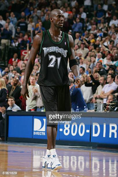 Kevin Garnett of the Minnesota Timberwolves walks on the court during the game against the Dallas Mavericks at American Airlines Arena on November 22...