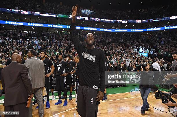Kevin Garnett of the Minnesota Timberwolves waves to the crowed during the game against the Boston Celtics on December 21 2015 at TD Garden in Boston...