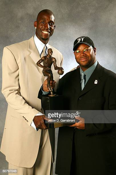 Kevin Garnett of the Minnesota Timberwolves with Jimmy Jam receives the NBA MVP award on May 3, 2004 at the Target Center in Minneapolis, Minnesota....