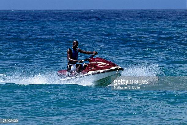 Kevin Garnett of the USA Men's National Basketball Team rides on a jet ski during the 2000 Olympics in Sydney Australia NOTE TO USER User expressly...