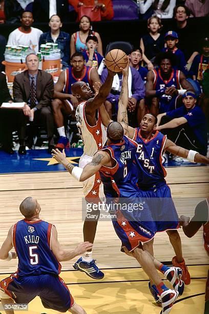 Kevin Garnett of the Western Conference AllStars rebounds against Kenyon Martin of the Eastern Conference AllStars during the 2004 AllStar Game on...