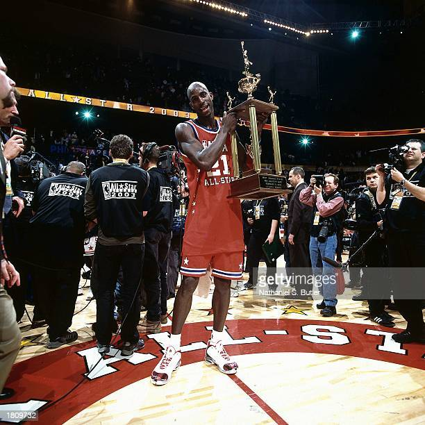 Kevin Garnett of the Western Conference AllStars wins the MVP Trophy after the 52nd NBA AllStar Game at the Phillips Arena on February 9 2003 in...