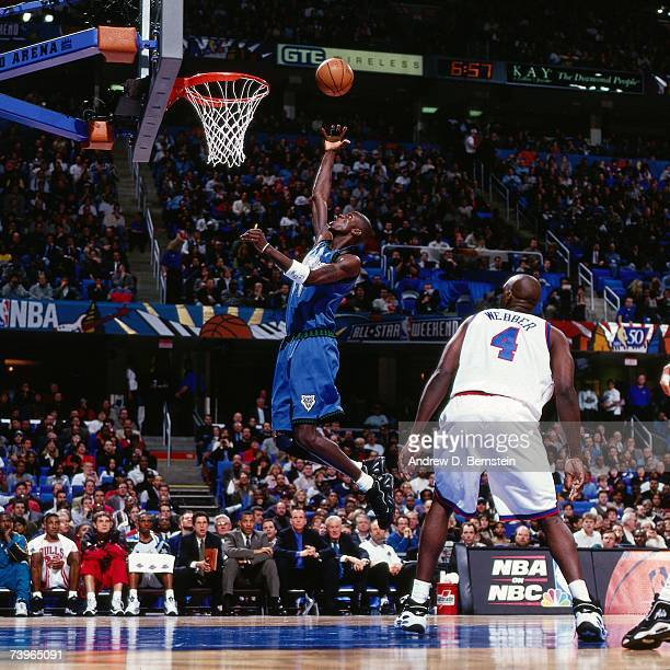 Kevin Garnett of the Western Conference grabs a rebound against Chris Webber of the Eastern Conference during the 1997 AllStar Game on February 9...
