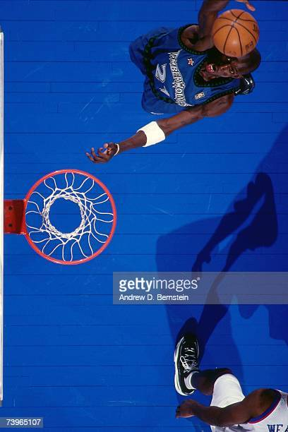 Kevin Garnett of the Western Conference grabs the rebound against Chris Webber of the Eastern Conference during the 1997 AllStar Game on February 9...