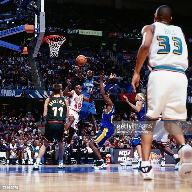 Kevin Garnett of the Western Conference passes against Tim Hardaway of the Eastern Conference during the 1997 AllStar Game on February 9 1997 at Gund...