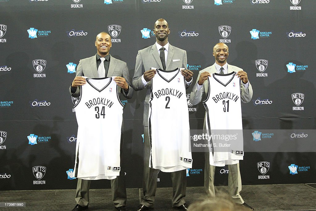 Kevin Garnett #2, Paul Pierce #34, and Jason Terry #31 of the Brooklyn Nets pose with their new jerseys during a press conference at the Barclays Center on July 18, 2013 in the Brooklyn borough of New York City.