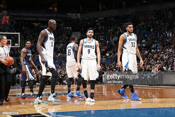 Kevin Garnett Ricky Rubio and KarlAnthony Towns of the Minnesota Timberwolves looks on against the Memphis Grizzlies on January 23 2016 at Target...