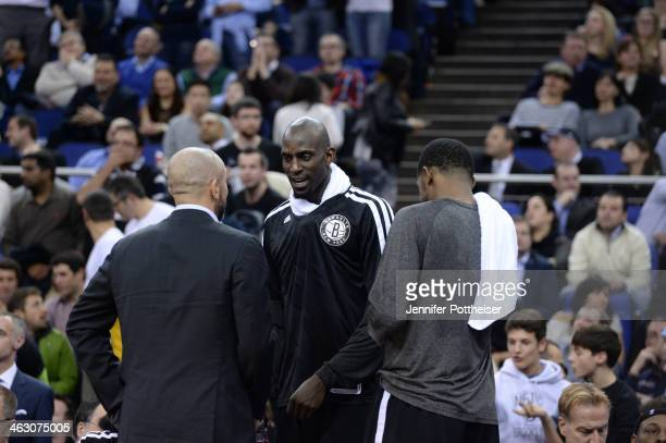 Kevin Garnett speaks to Head Coach Jason Kidd of the Brooklyn Nets against the Atlanta Hawks as part of the 2014 Global Games on January 16 2014 at...