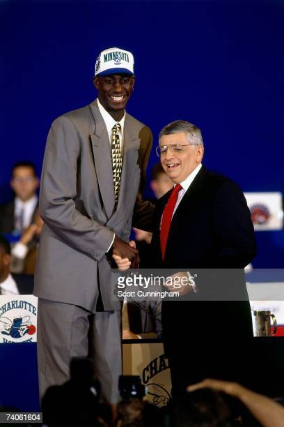 Kevin Garnett taken number five overall by the Minnesota Timberwolves shakes NBA Commissioner David Stern's hand during the 1995 NBA Draft on June...
