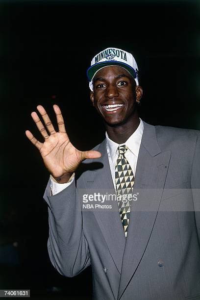 Kevin Garnett taken number five overall by the Minnesota Timberwolves smiles during the 1995 NBA Draft on June 28 1995 at the Toronto Skydome in...