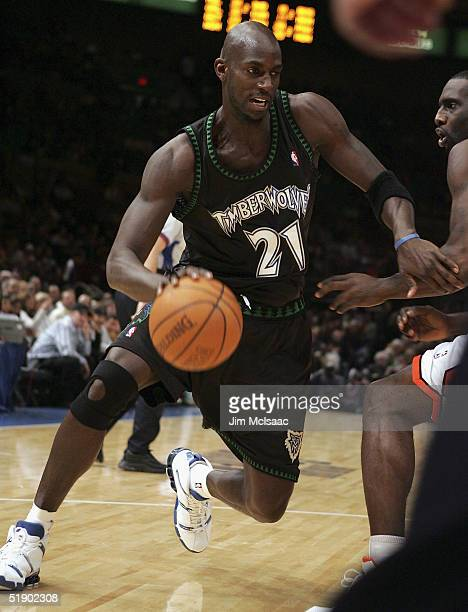 Kevin Garnett the Minnesota Timberwolves drives to the net against the New York Knicks during their game on December 29 2004 at Madison Square Garden...