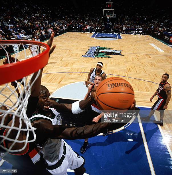 Kevin Garnett the Minnesota Timberwolves shoots during the game with the Portland Trail Blazers at Target Center on January 15 2005 in Minneapolis...
